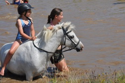 Kates Horse Riding Centre kerikeri -guide with child
