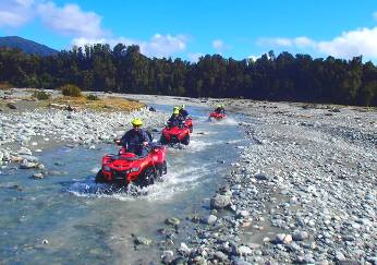 Across country Quad Bikes in river