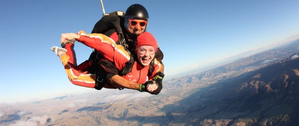 Tandem-skydive-wanaka-jumping-from-plane-view