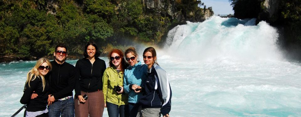huka-falls-cruise-tourists-under-waterfall-3