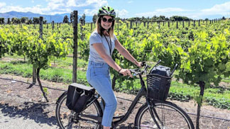 Young girl on guided wine tour by bike in Blenheim, Marlborough Vineyards