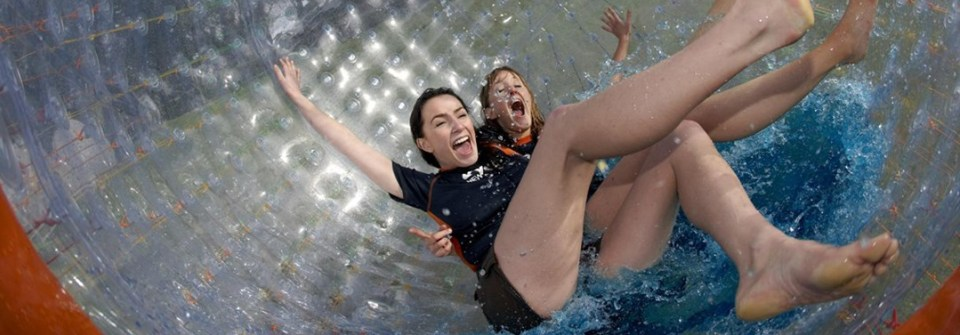 zorb-rotorua-top-attraction-girls-in-zorb-rolling