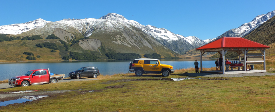 4 WD vehicles parked at Lake Tennyson on Molesworth Station