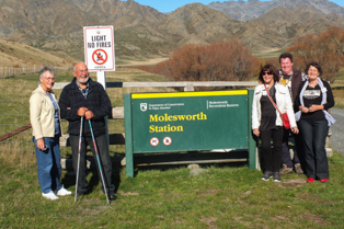 4 Wd tour group standing by Molesworth station sign board