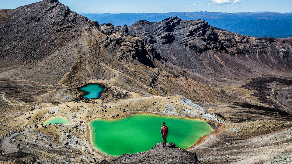 Girl Tramper looking down over Green Lakes on Tongariro Alpine Crossing