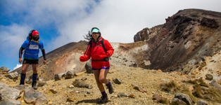 Girl Tramper running on Tongariro Crossing