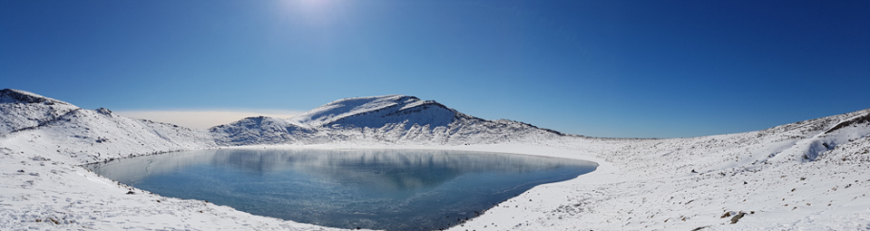 view over lake Tongariro Crossing covered with snow in winter