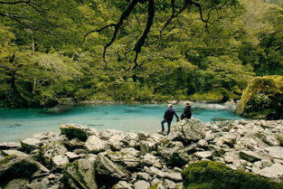 Young couple on the Dart River at Middle Earth film location for Lord of the Rings