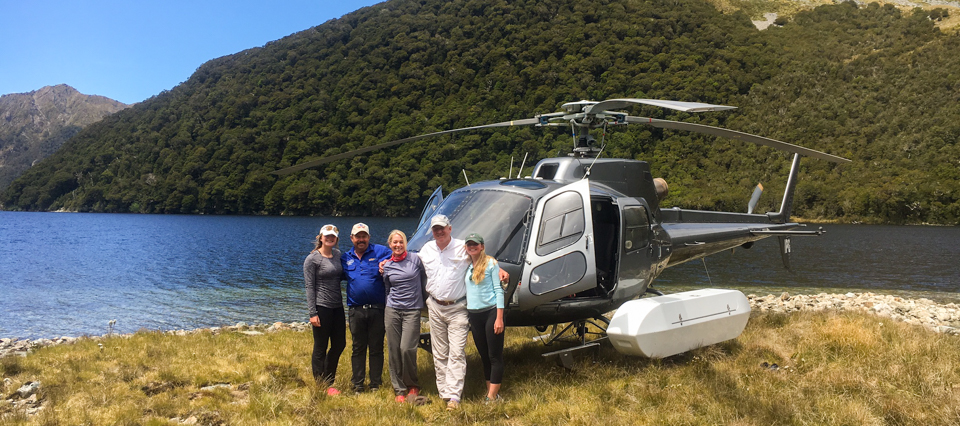 Two couples with Helicopter by a lake in the Mt. Aspiring National Park