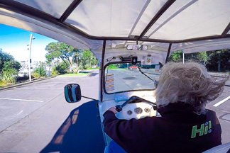 Kiwi tuk tuk driving through Auckland CBD