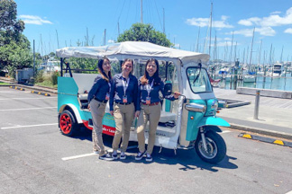 tourists on private Auckland's Kiwi tuk tuk tour