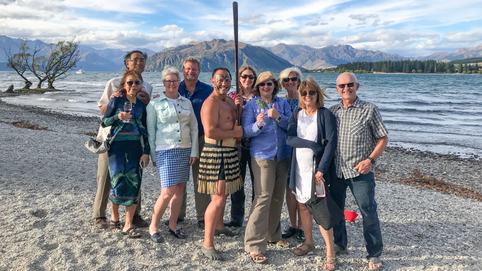 Maori Guide with tourist group on Wanaka lakeside near Lone Tree