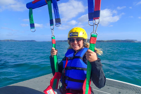 Single girl in parasail Bay of Islands