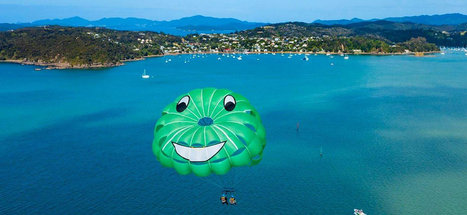 Parasail trip at 1300 feet with views over Russell and the Bay of Islands